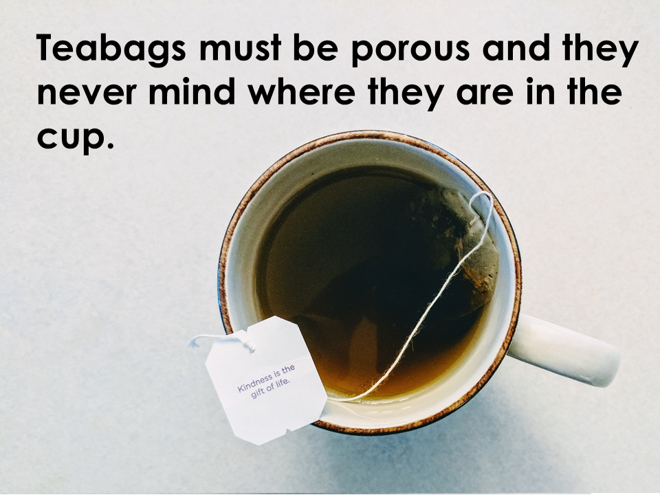 A teabag must be porous. They never mind where they are in the cup.